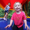 Lowell Elks hold fundraiser to benefit Wounded Warriors. Mia Colon, rear, and Lylah Beaulieu, both 3 and neighbors from Lowell, play in the bouncy house. (SUN/Julia Malakie)