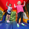 Lowell Elks hold fundraiser to benefit Wounded Warriors. Mia Colon, left, and Lylah Beaulieu, both 3 and neighbors from Lowell, play in the bouncy house. (SUN/Julia Malakie)