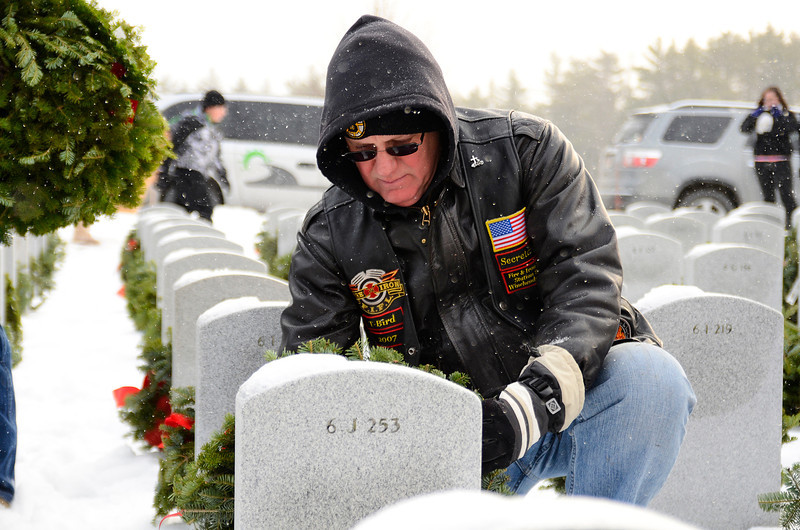 Richard Creamer of Winchendon, whose father was a World War 2 P.O.W. veteran, places a wreath at a headstone in the Massachusetts Veterans' Memorial Cemetery in Winchendon as part of the Wreaths Across America program, Friday morning.<br /> SENTINEL & ENTERPRISE / BRETT CRAWFORD