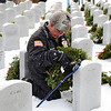 Vietnam Veteran Marshall Searles of Winchendon, a member of VVA Chapter 907 in Gardner, places a wreath at a headstone in the Massachusetts Veterans' Memorial Cemetery in Winchendon as part of the Wreaths Across America program, Friday morning.<br /> SENTINEL & ENTERPRISE / BRETT CRAWFORD