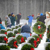Volunteers place wreaths at headstones in the Massachusetts Veterans' Memorial Cemetery in Winchendon as part of the Wreaths Across America program, Friday morning.<br /> SENTINEL & ENTERPRISE / BRETT CRAWFORD