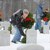"Vietnam Veteran Jay Ringquist of Ashburnham, who goes by the nickname ""Digger"" in the Patriot Guard Riders group, places a wreath at a headstone in the Massachusetts Veterans' Memorial Cemetery in Winchendon as part of the Wreaths Across America program, Friday morning.<br /> SENTINEL & ENTERPRISE / BRETT CRAWFORD"