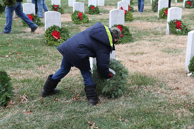 Aaron lays a wreath