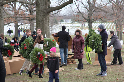 participants receive wreaths from the various trucks and go to their assigned areas