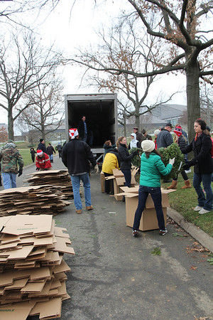 volunteers hand out wreaths and break down boxes