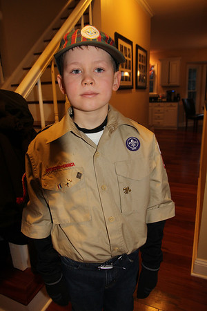 showing off his great-granddaddy's boy scout pins on his shirt