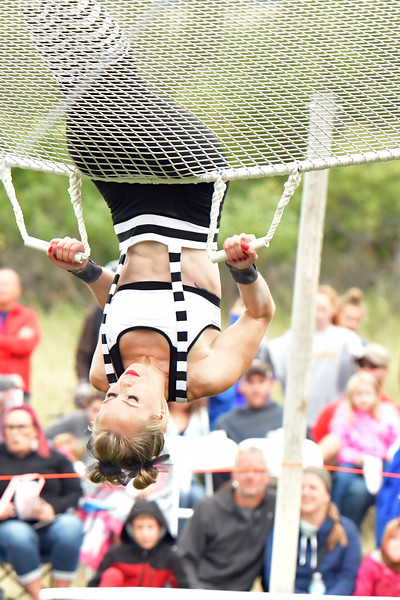 Matthew Gaston | The Sheridan Press<br>Carrie Steinhorst flips off the saftey net after performing during the WyFly Flying Trapeze Show Saturday, Sept. 7, 2019.