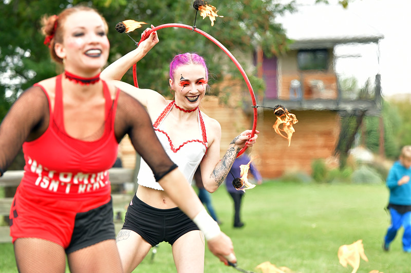 Matthew Gaston | The Sheridan Press<br>Rosemary Moot dances with a flaming hula hoop before the WyFly Flying Trapeze Show in Big Horn Saturday, Sept. 7, 2019.