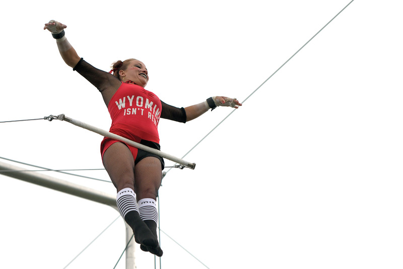 Matthew Gaston | The Sheridan Press<br>Trapeze artist Julianna Richards sores above the crowd during the WyFly Flying Trapeze Show Saturday, Sept. 7, 2019.