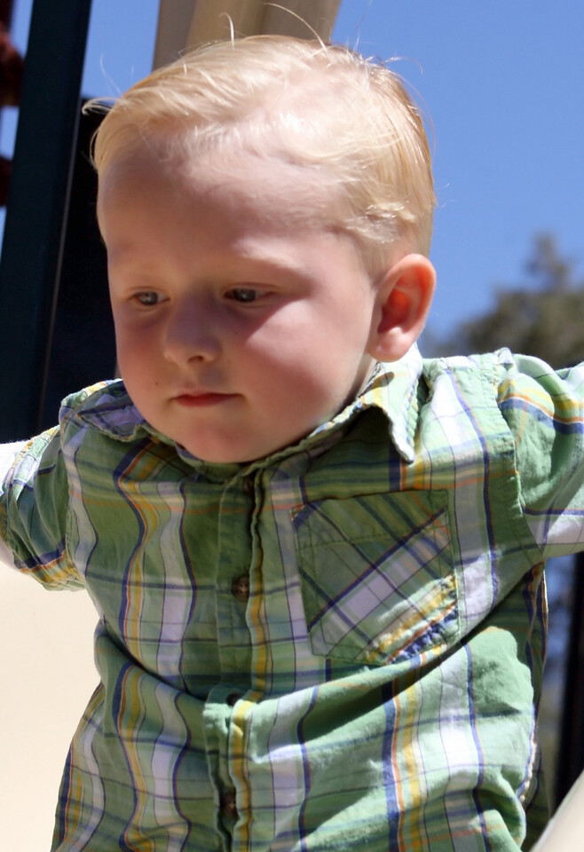 Birthday boy Wyatt on the slide 1