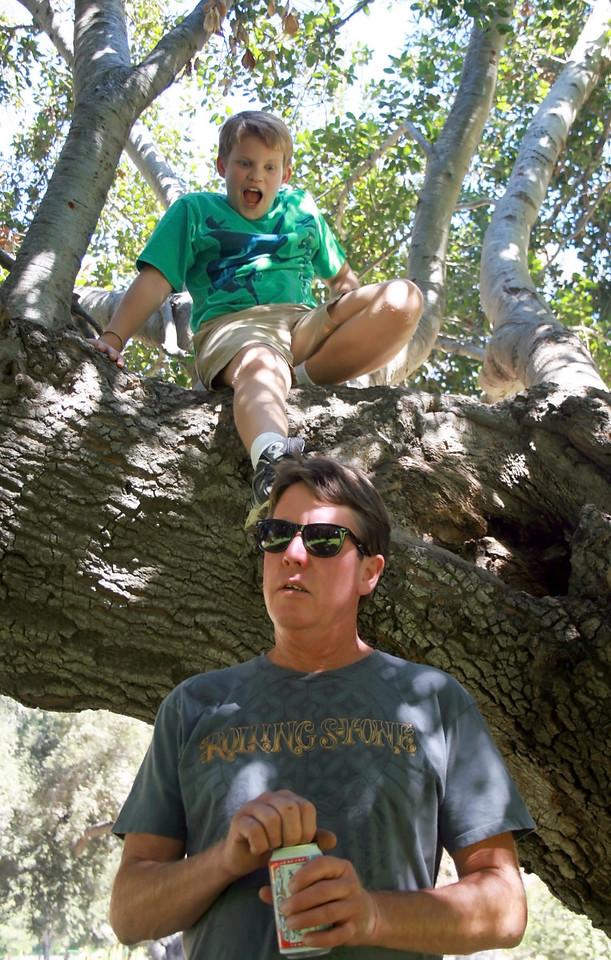 Devan and Uncle Steve under the cool oak tree