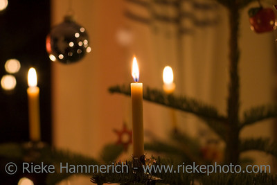 beeswax candles on a christmas tree - romantic lighting - adobe RGB