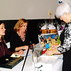 Debbie Blank | The Herald-Tribune<br /> Board member Lori Pulskamp (from left) and senior adults and volunteers director Bonnie Pratt help member Floanna Zeigler participate in the raffle. Proceeds benefitted sixth-grade free memberships and senior programs.