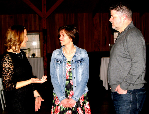 Debbie Blank | The Herald-Tribune<br /> Y executive director Angie Harmeyer (from left) chats with Katie and Troy Sparks, Greensburg.