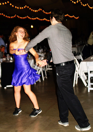 Debbie Blank | The Herald-Tribune<br /> Y dance instructor Lizzy Moeller (left) and Jared Russell, Mount Healthy, Ohio, moved to joyous tunes by area band Nuttin' Fancy.