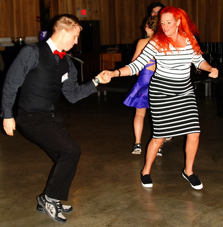 Debbie Blank | The Herald-Tribune<br /> Dr. Chris and Laura Ault, who have taught ballroom dancing and Zumba at the Y for years, move to the music of local favorite Nuttin' Fancy.