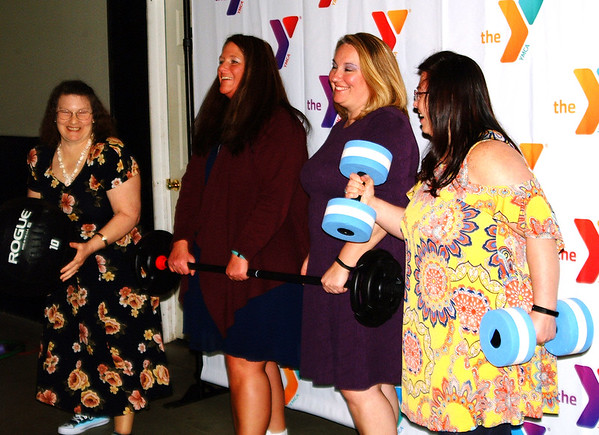 Debbie Blank | The Herald-Tribune<br /> Marketing coordinator Kathleen Bohman (not pictured) was kept busy taking photos of Sneaker Ball attendees, including these friends with appropriate props.