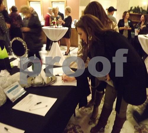 Aber Barwin and Cara Bockes signing up for items.