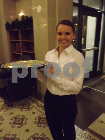 Emma Gibson serving food.