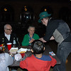 Circus performer doing card tricks with older Armenian-speaking couple !