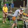 Bill and Jim cutting posts