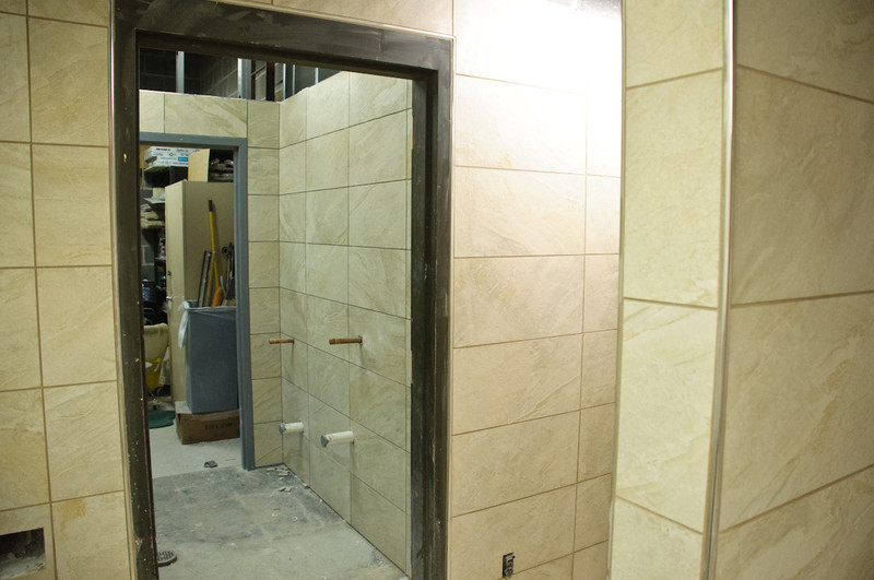 Additional urinal space got tiled today.