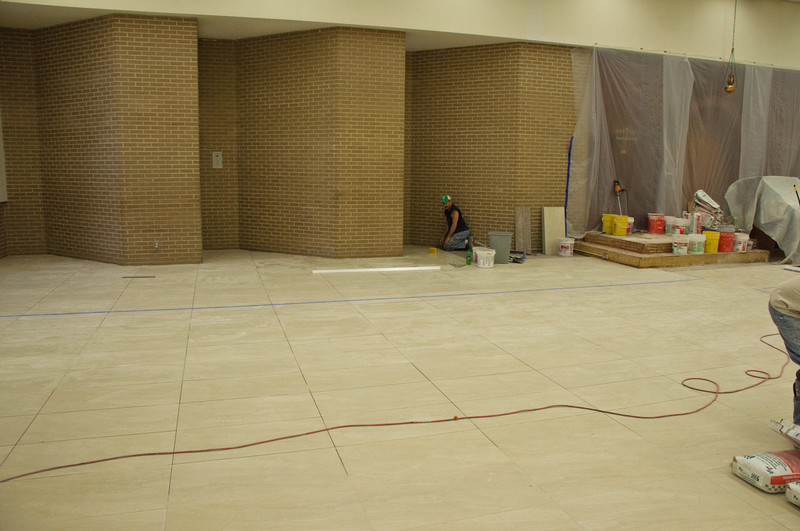 a few more tiles, a bit of grout and  they will be done with the bais medrash floor