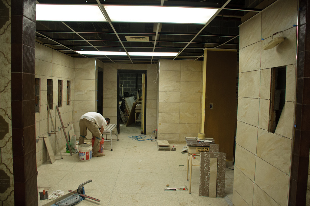 Lobby handwashing stations walls being tiled
