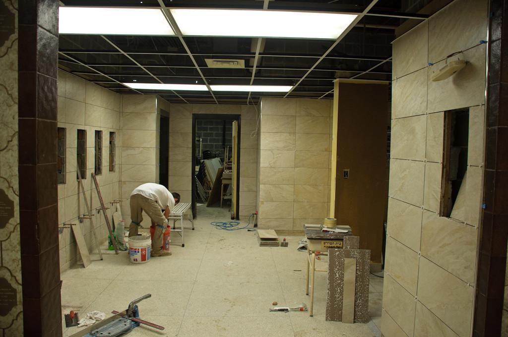 Lobby handwashing stations walls being tiled