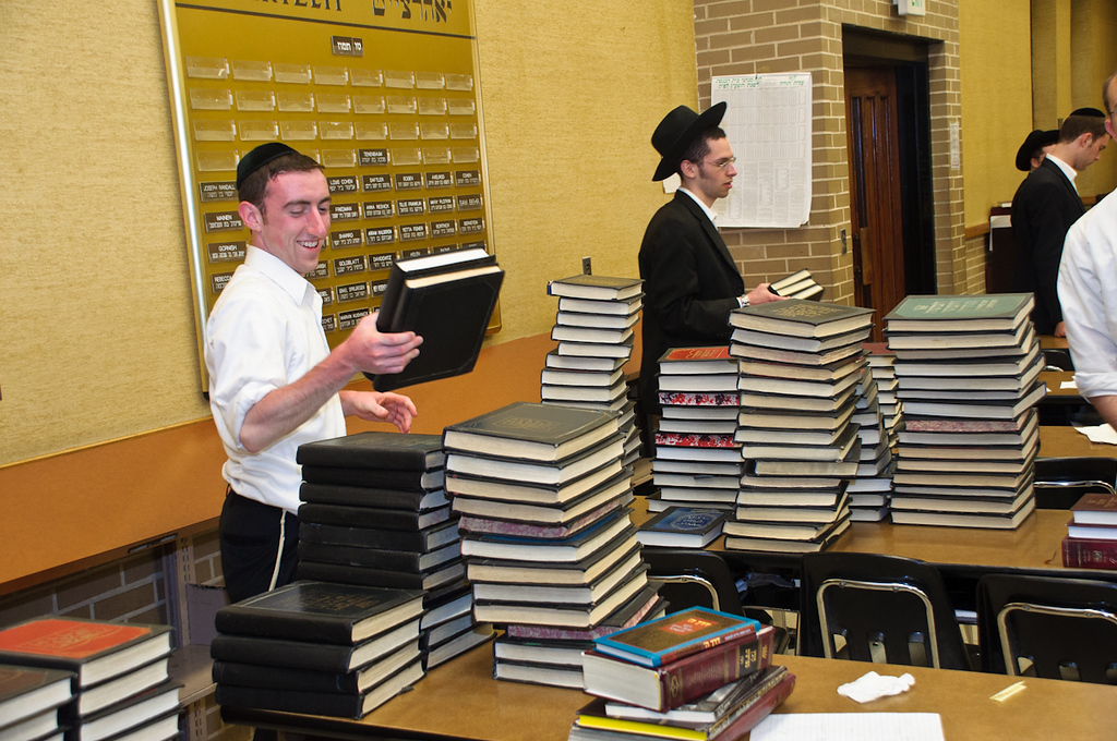 Bochurim moving Seforim from the Bais Medrash into Rabbi Nusbaum's blatt room and the Mechina Bais Medrash
