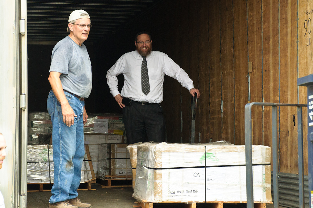 Large shipment of tile arrives for the yeshiva bais medrash floor and bathroom