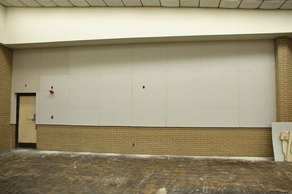 Prepping the walls in the Bais Medrash for wallpaper