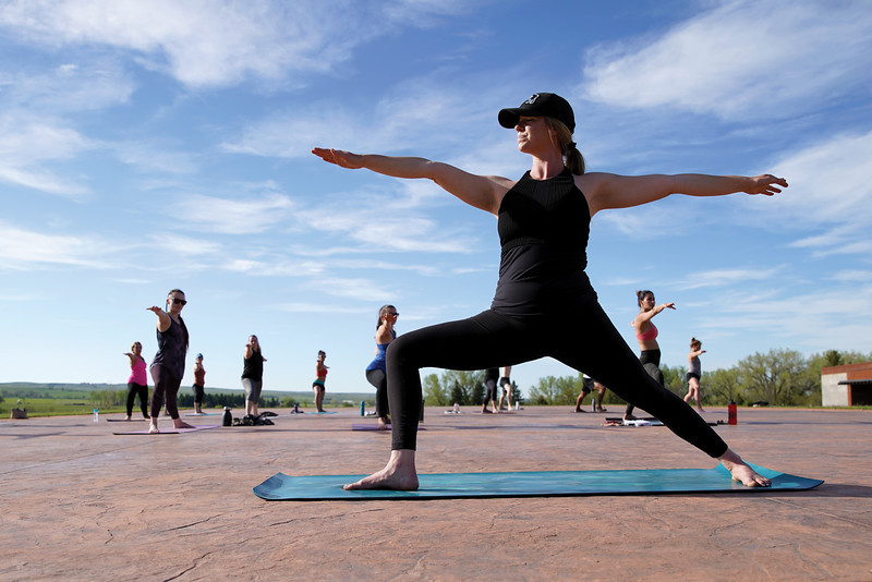 Matthew Gaston | The Sheridan Press<br>Kula Space's Tanya Moon  leads practitioners through a yoga flow at The Brinton Museum Tuesday, May 19, 2020.
