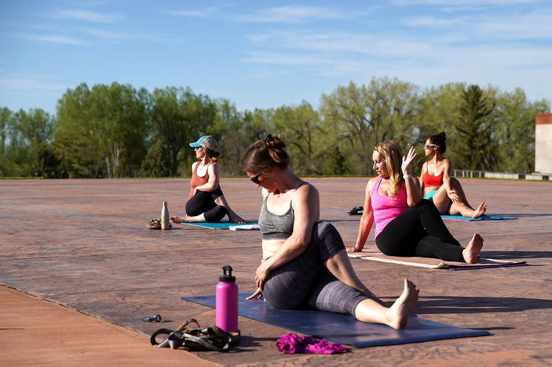 Matthew Gaston | The Sheridan Press<br>From left, Kelli Johnson, Erin Lehman, Karol Meineke and Valery Notaro perform the final stretch before moving into shavasana during Yoga at The Brinton Tuesday, May 19, 2020.