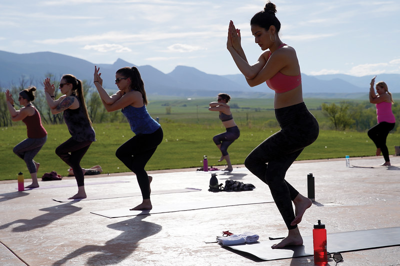 Matthew Gaston | The Sheridan Press<br>Yoga practitioners, from left, Tressa Lawrence, Cassie Jaeb, Monica Riesch, Erin Lehman, Lauren Nieves and Karol Meineke perform eagle pose during Kula Space's Yoga at The Brinton Tuesday, May 19, 2020.