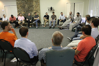 Young men gather in a large circle during the men's breakout session, where a discussion was led by Franciscan Friars of the Renewal Brother Innocent Montgomery and Father Gabriel Bakkar.