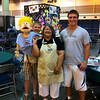 Women of the ELCA staff member, Inez (middle), and Lutheran Gus (puppet, left) pose with two participants.