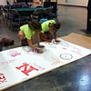 """Two participants make their mark on the graffiti """"wall"""" in the Hot Spot area."""