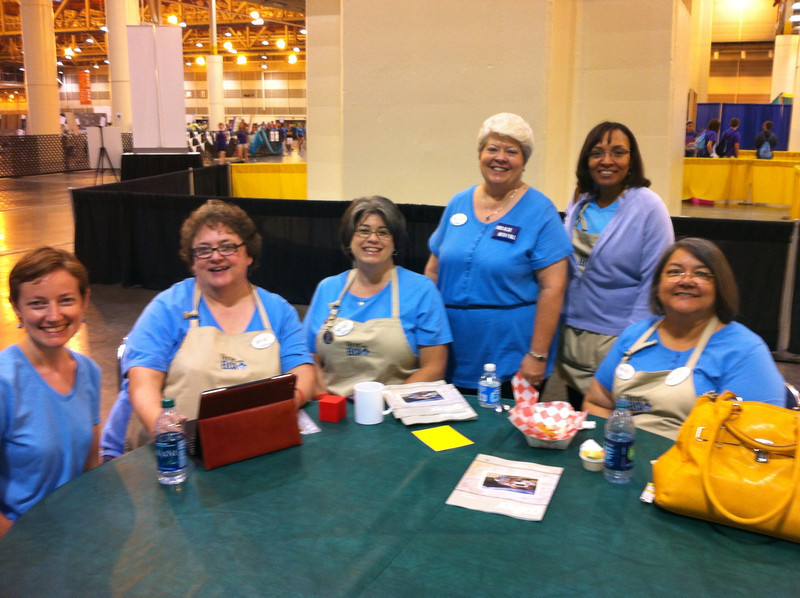 Women of the ELCA staff and churchwide executive board officers greet Hot Spot visitors with a smile. From left: Emma Crossen, Linda Post Bushkofsky (Executive director), Jennifer Michael (Churchwide executive board president), JoAnn Fuchs (Churchwide executive board vice president), Deborah Powell, and Inez Torres Davis.