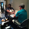 Churchwide staffer Ann gives a hand massage to one of the guys who stopped by our spa.
