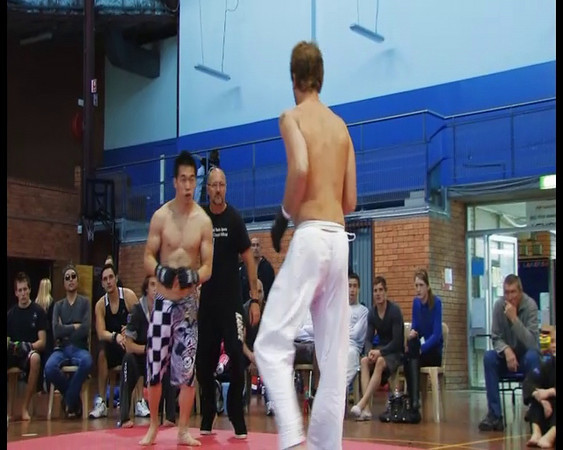 """Vidal Stand Up and Ground Fighting Mix in one. A form of MMA. Held at the EDSAC Stadium 2009 August. Part of the Budo Sports Championships .<br /> Visit Their Site Here.<br /> <a href=""""http://www.zenbukan.com.au/"""">http://www.zenbukan.com.au/</a><br /> <br /> Also visit <a href=""""http://www.zenjitsukai.net/zjk/index.htm"""">http://www.zenjitsukai.net/zjk/index.htm</a>"""