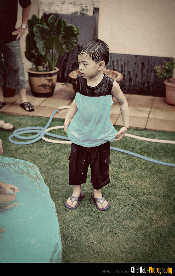 "Zhi... please take off your shirt before you go into the pool ya. :P (Althought he is pretty much soaking WET) :""P"