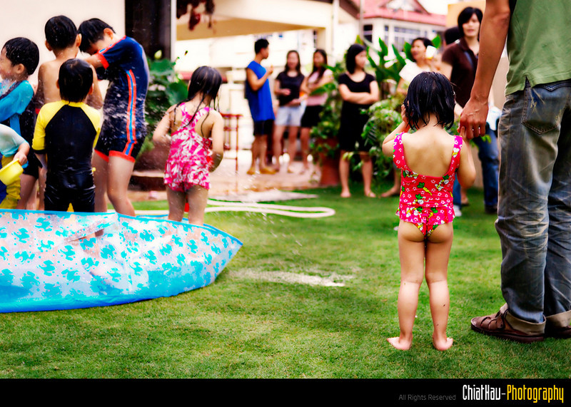 "This little girl cried due to the intensity of the water battle... ~:""P"