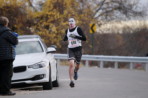 Record-Eagle/Keith King<br /> Grant Woods, of Rapid City, won first place overall and in the male division Saturday, October 27, 2012 during the fourth annual Zombie Run 5k in Traverse City with proceeds from the run/walk going toward TART Trails.
