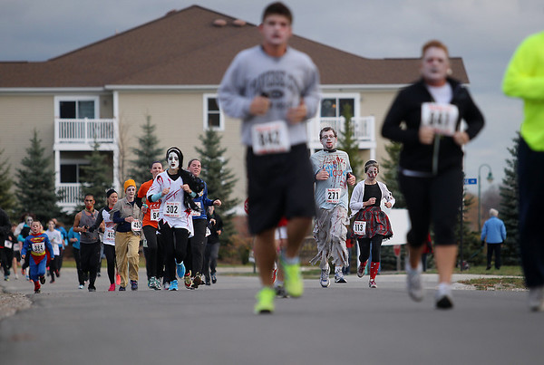 Record-Eagle/Keith King<br /> Participants near the finish line Saturday, October 27, 2012 during the fourth annual Zombie Run 5k in Traverse City with proceeds from the run/walk going toward TART Trails.
