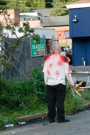 Red, White and Dead zombie walk 2010 - Smoke break from the zombie apocalypse.