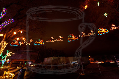 Santa's sleigh, pulled by two reindeer, but the exposure was so long that it caught Santa and reindeer in four positions. Only one position is on at a given time. It starts on the left and flies up to the right, one frame at a time..