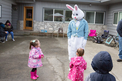Olivia is not sure what to think of the Easter Bunny! :)