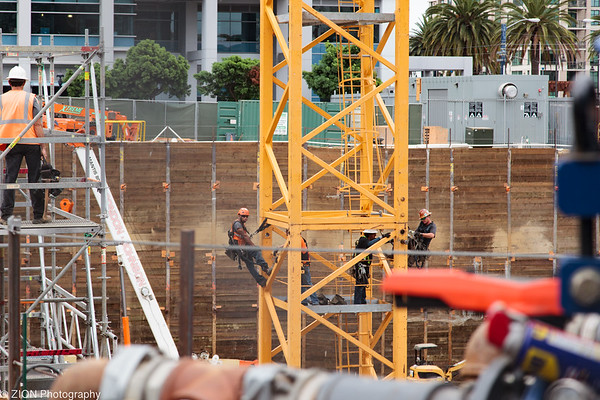 A crew builds a crane in downtown San Diego