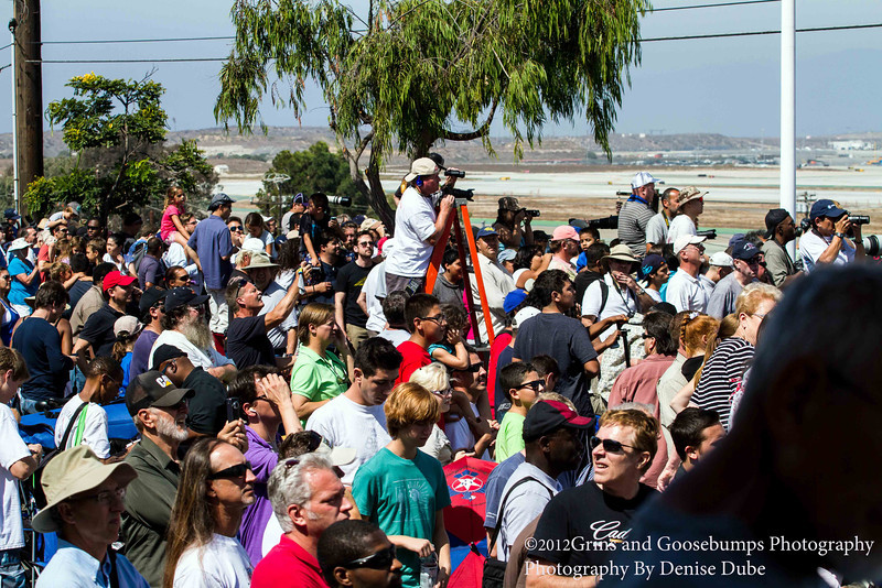 """""""News said the Endeavor is fly over l<br /> Long Beach Quean Mary on her way here to LAX"""" Crowd cheers.. I was invited by the City of El Segundo to capture the fly by's and final landing of the Space Shuttle Endeavor. Here I have captured her final landing at LAX."""